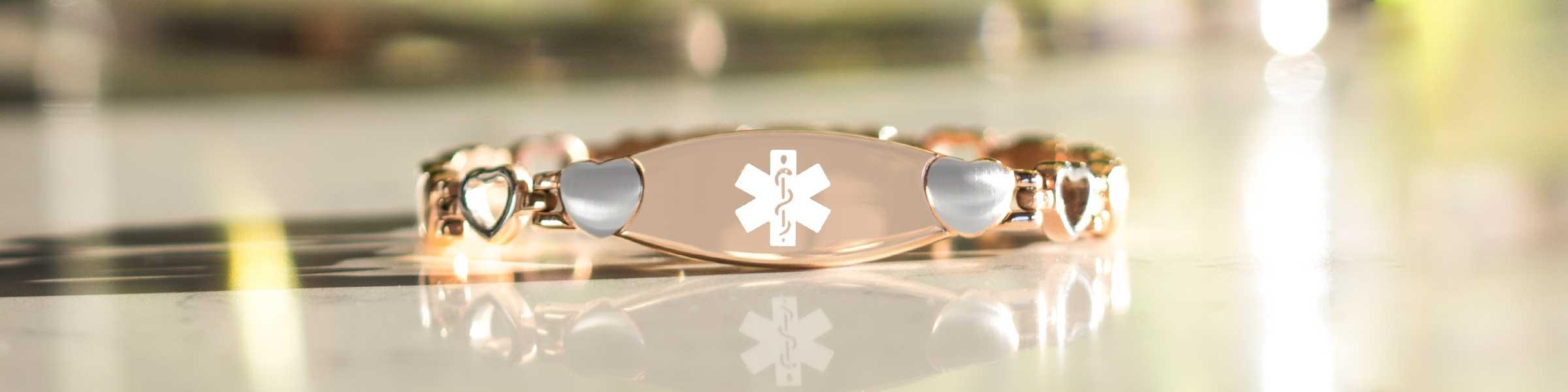 Rose gold medical alert bracelet with heart links