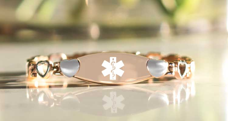 Rose gold medical alert bracelet with heart links