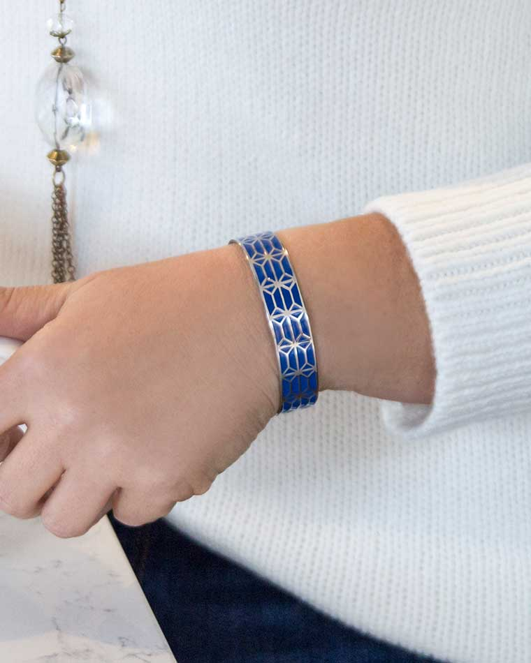 Brooke Medical ID Cuff - women in white sweater wearing blue and silver medical ID cuff bracelet