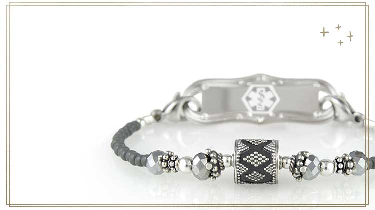 Stretch medical ID bracelet with detailed centerpiece bead and decorative medical ID tag