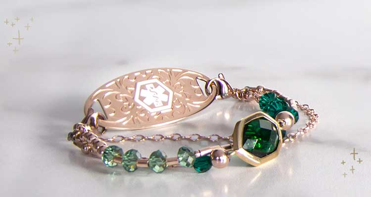 Rose gold beaded medical ID bracelet with emerald green crystals and accents