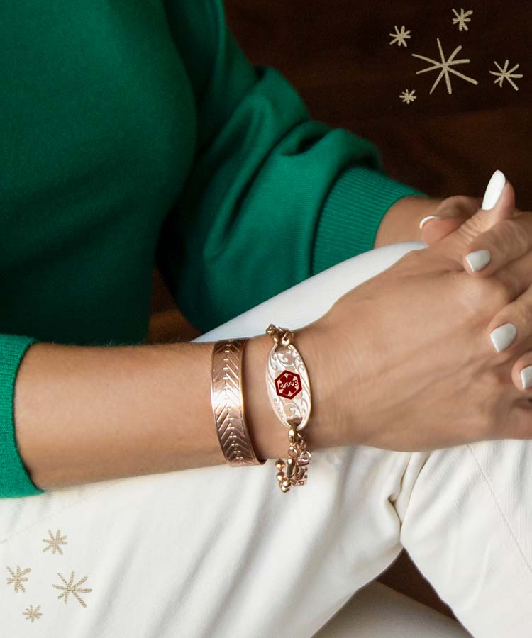 Woman wearing rose gold medical ID cuff with rose gold ID tag