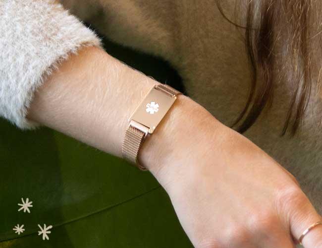 Woman wearing rose gold Urban medical ID bracelet