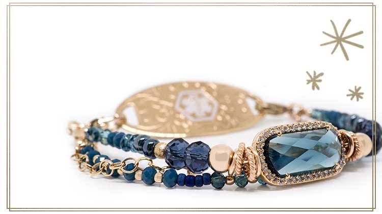 Rose gold beaded medical ID bracelet with navy blue beads and center stone