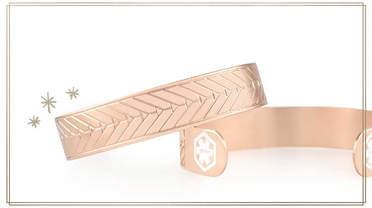 Rose gold medical ID cuffs with white symbols and etched pattern