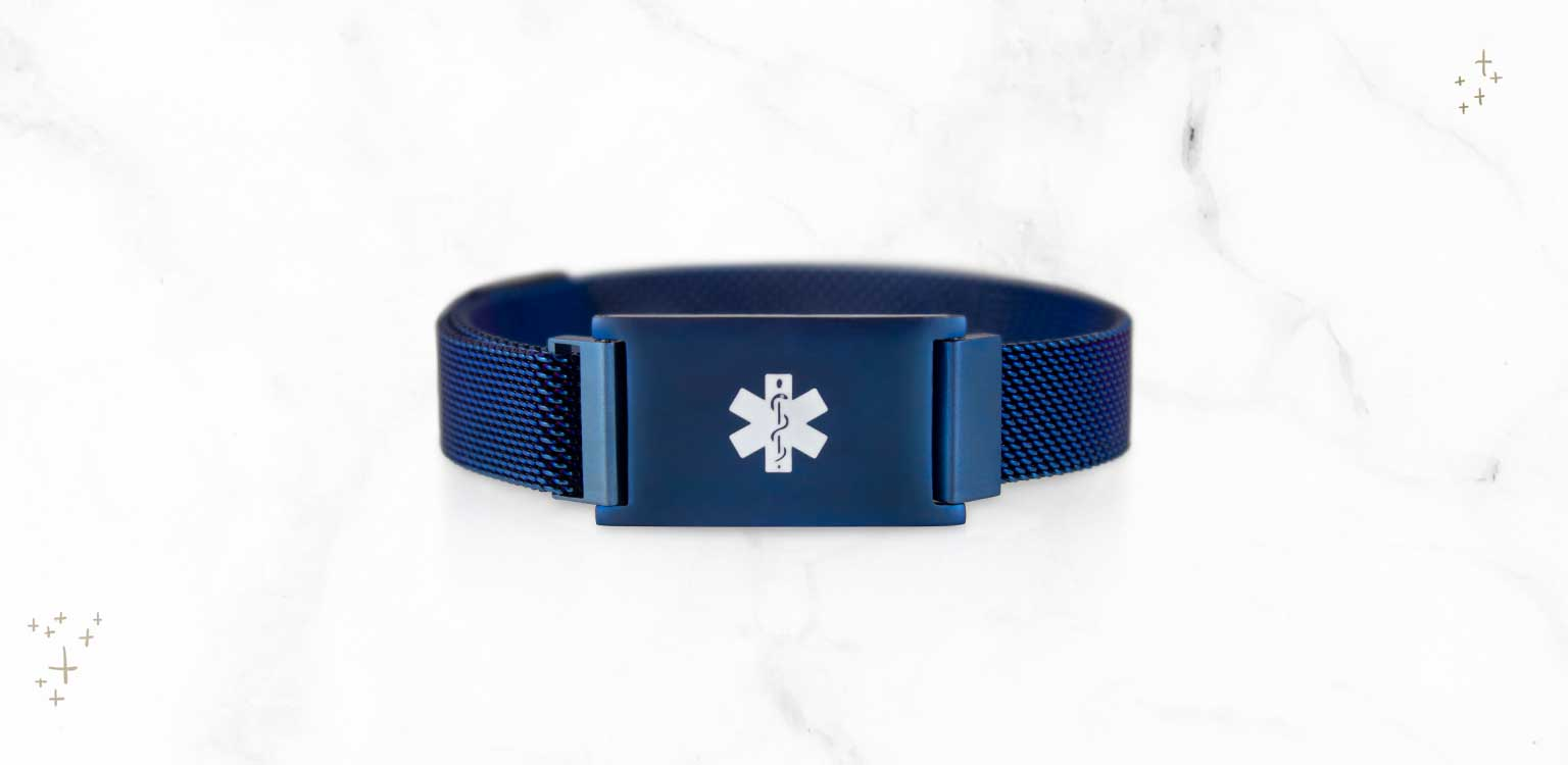 Blue medical ID bracelet with magnetic closure and white medical caduceus symbol on marble background