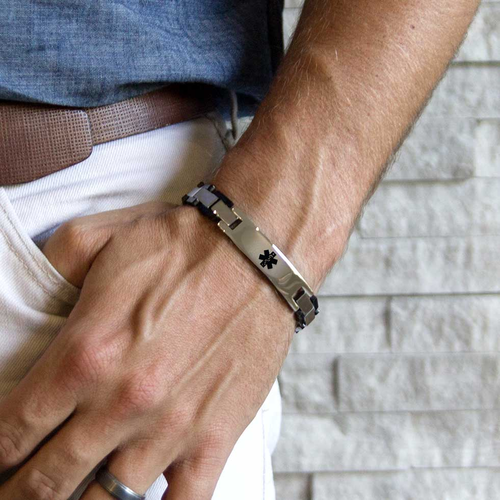 Man wearing silver and black tone linked medical ID bracelet