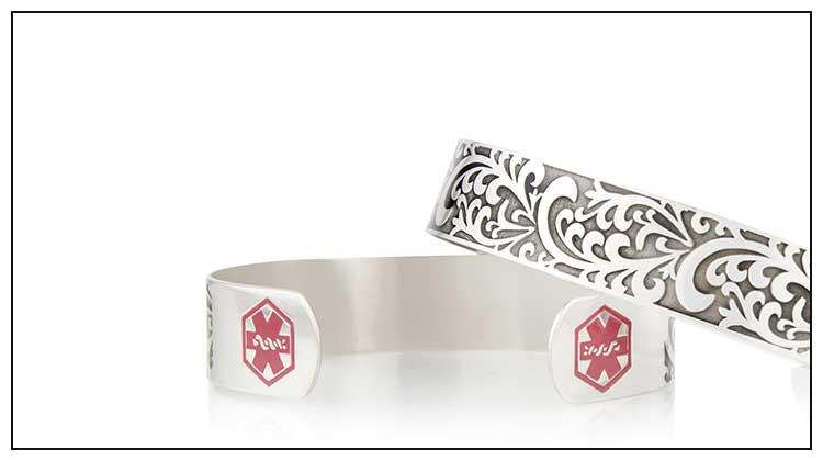 Silver tone medical ID cuff with decorative filigree pattern