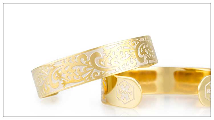 Gold tone medical ID cuff with decorative filigree pattern