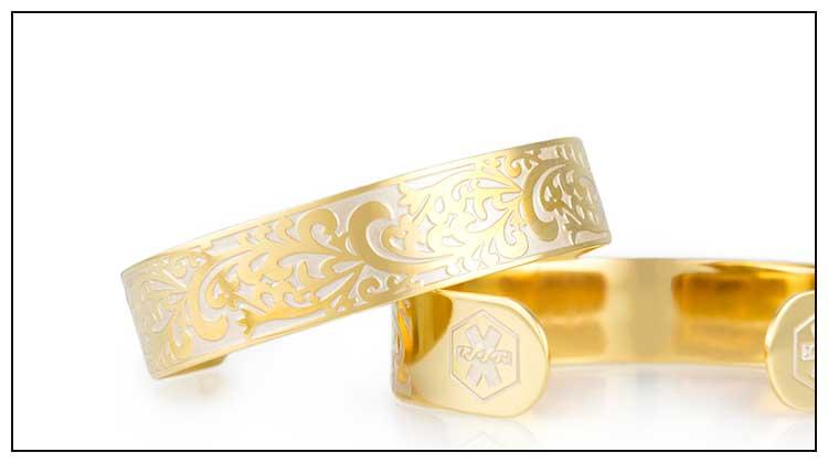 Gold tone medical ID cuff with decorative filigree pattern