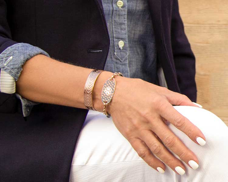 Woman wearing a blazer and rose gold medical alert bracelets