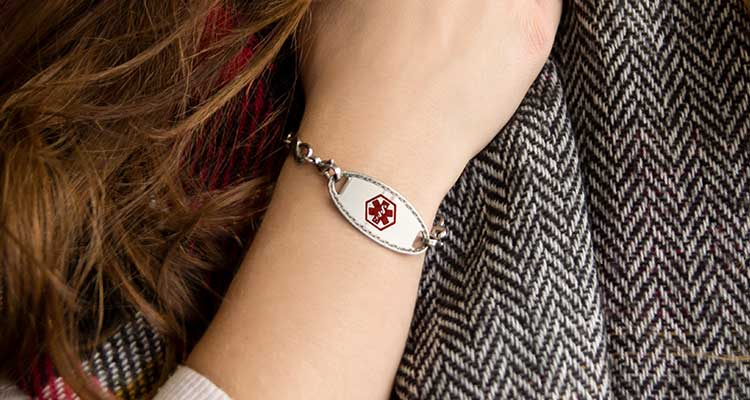 Woman wearing scarf and medical alert bracelet