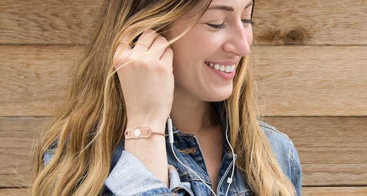 Smiling woman wearing rose gold medical alert bracelet