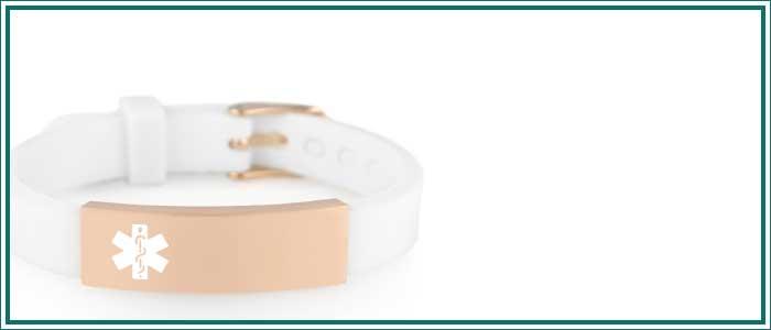 Rose gold and white silicone medical alert bracelet on white background
