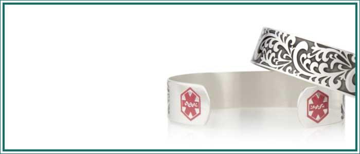 Silver tone medical alert cuff with decorative filigree swirls