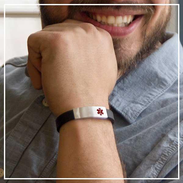 Smiling man wearing silicone medical alert bracelet