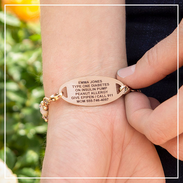 Woman showing medical alert tag with custom engraving