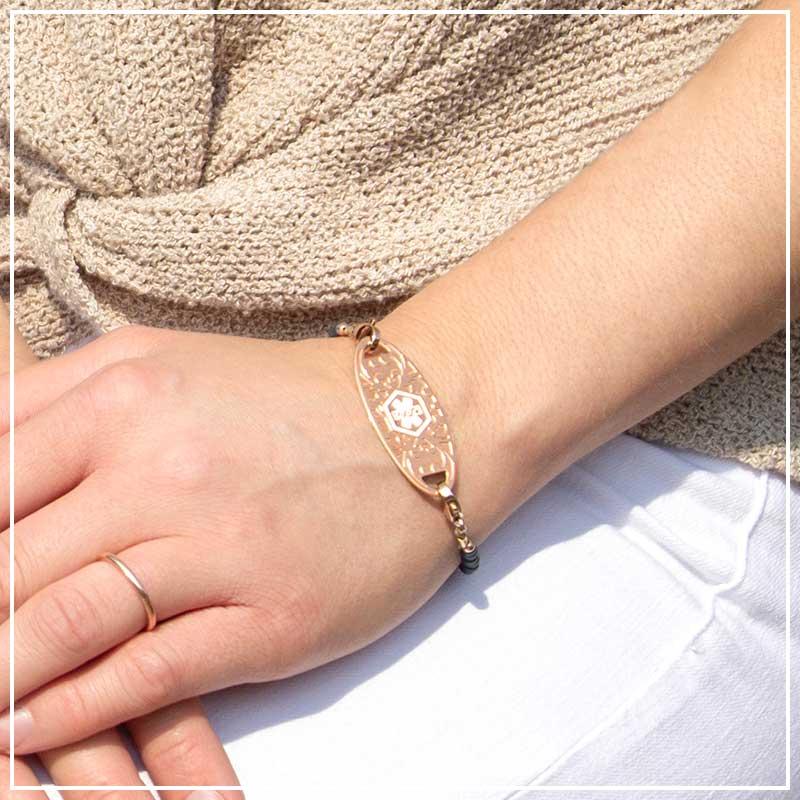 Woman wearing rose gold medical alert bracelet