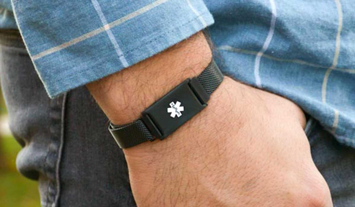 Man wearing black adjustable magnetic medical alert for weight loss surgery
