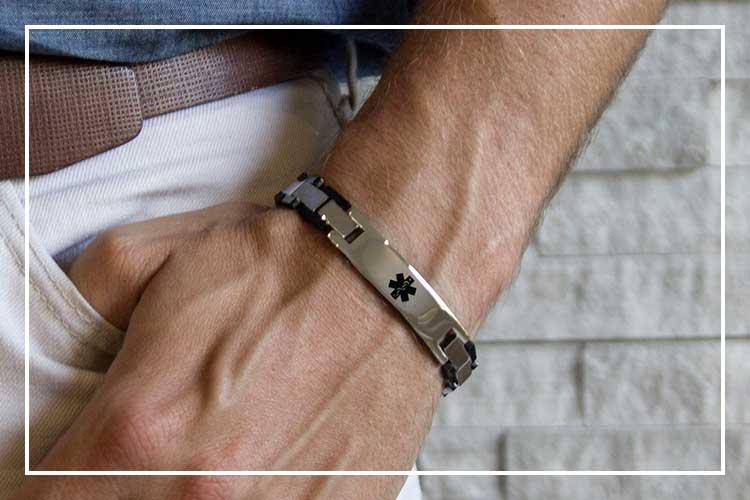 Man wearing silver and black linked medical alert band