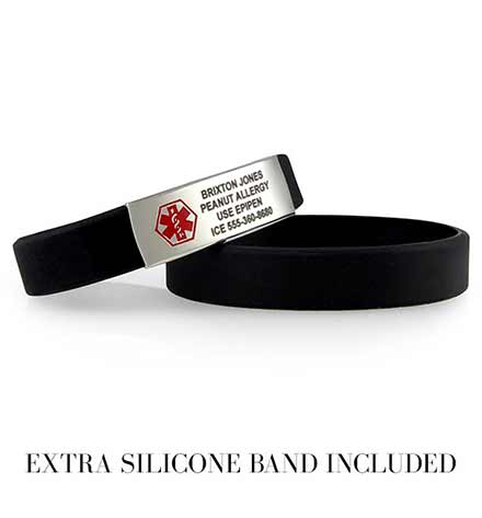 Two stacked black silicone bands, one with a silver tone medical ID tag, sample engraving and red symbol