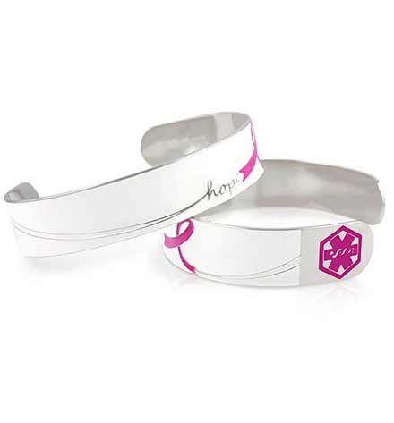 "Back and front of Hope Medical ID Cuff. Stainless cuff, white background, pink ribbon, word ""hope"", pink caduceus each end"