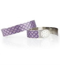 Ladies med ID cuff featuring a silver tone interlocking floral pattern raised above a purple background.