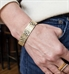 Woman wearing Golden Filigree Medical ID Cuff. Front of stainless yellow gold tone filigree cuff with pearlescent finish
