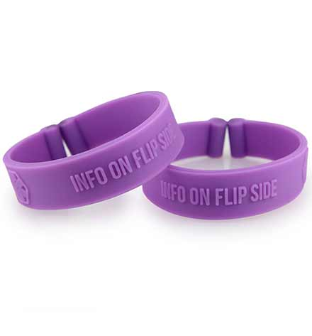 "Two purple silicone bands with debossed medical symbols and the words, ""Info on flip side"" without tags"