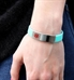 Woman wearing a Sky Blue ActiveWear Slim Medical ID Bracelet. Silicone circle band with stainless plaque with red caduceus