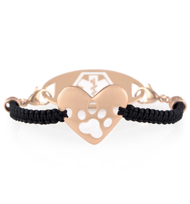Puppy Love Medical ID Bracelet. A rose gold tone heart centerpiece, paw print cutout, black macrame stranding, and med ID tag
