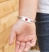 Young girl wearing the La Petite Medical Tag on the Prism Medical ID Bracelet, a flat leather band with multi-color sparkles
