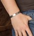 Man wearing the Sleek Mini Med ID Cuffs in Silver with a smooth brushed surface, showing the front side with brushed surface