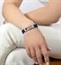 Woman wearing denim blue silicone activewear medical alert sport band