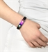 Woman wearing magic activewear fit in black medical alert band with multicolor ID tag