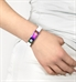 Woman wearing magic activewear fit in white medical alert band with multicolor ID tag