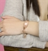 rose gold tone gardenia medical ID tag shown on wrist