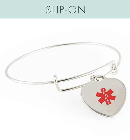 """Liz Charm Bangle Medical ID. Silver tone stainless bangle bracelet and heart charm with red caduceus. With words, """"SLIP-ON"""""""