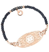 Deep blue frost seed beads and crystals with rose gold filled accents and a Rose gold circle charm with heart cutout charm