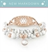 White marbled beads accented with rose gold beads bracelet strand attached to medical ID tag