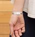 mon petite medical ID tag shown on wrist