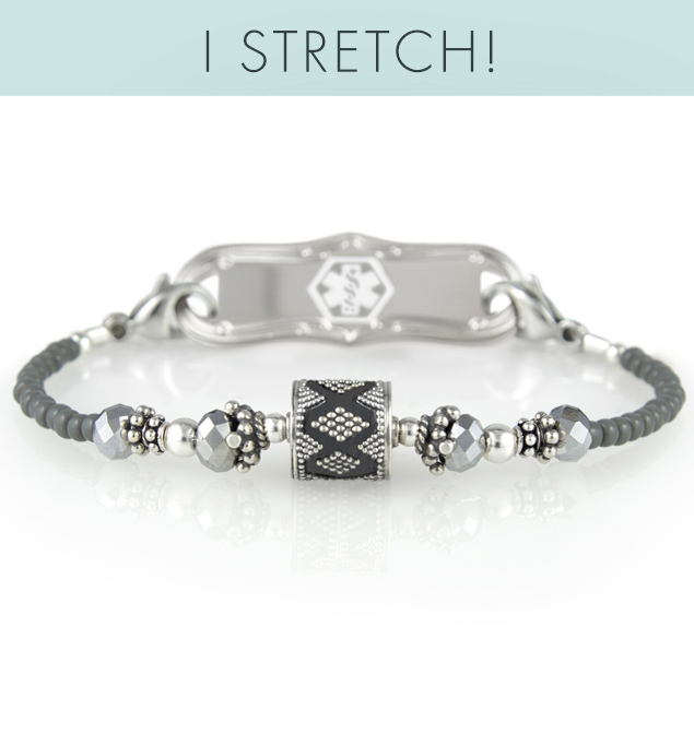 Grey and silver single-strand beaded bracelet with detailed focal bead and silver tone medical alert tag