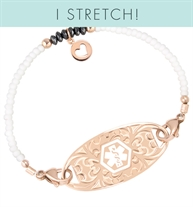 White seed beads and crystals with rose gold filled accents and a Rose gold circle charm with heart cutout