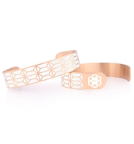 Flexible rose tone cuff with cream paint inside the inlaid geometric pattern. Medical symbol on each end.