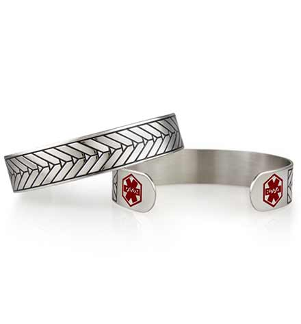 Med alert cuff with silver and dark inlay in an arrow pattern and red alert symbols
