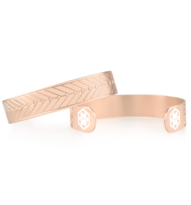 Rose gold medical ID cuff with white medical caduceus symbols