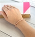 Woman wearing rose gold ball chain medical ID bracelet