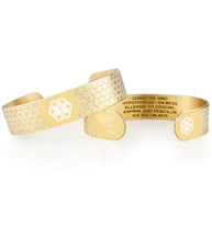 Gold tone medical ID cuff with decorative pattern and white medical caduceus symbol