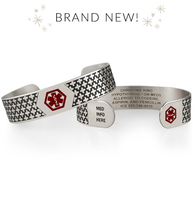 Silver tone medical ID cuff with decorative pattern and red medical caduceus symbols