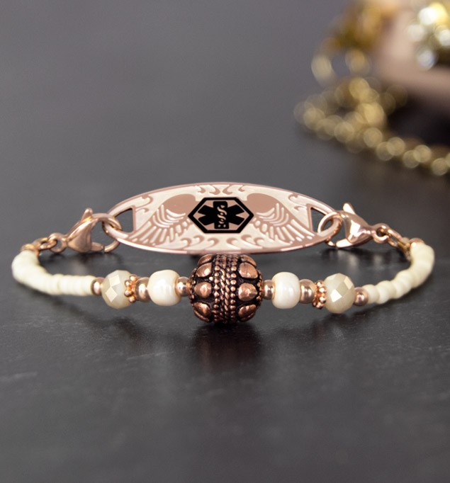 Rose gold beaded stretch medical ID bracelet with rose gold balis bead on slate